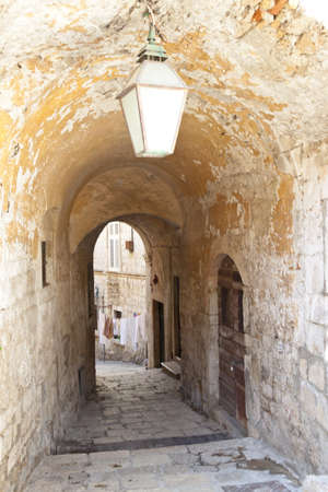 Narrow old alley in Dubrovnik town. photo