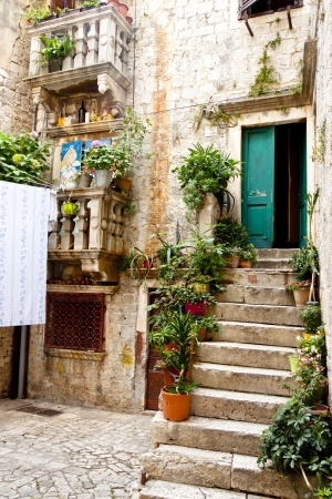 view of a wooden doorway: Beauty and colorful courtyard in Trogir, Croatia