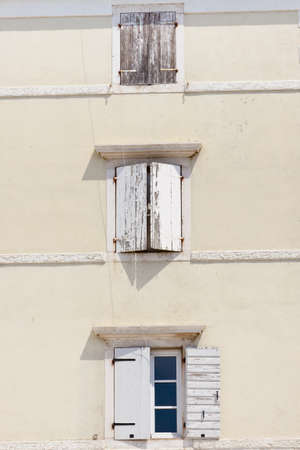 White wall with three windows - Trogir, Croatia  photo