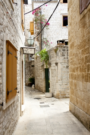 Beauty old narrow alley in town, Trogir - Croatia  Stock Photo