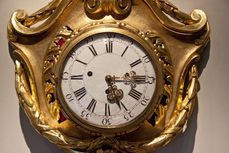 Old golden clock on the wall - Pieskowa Skala Palace  photo