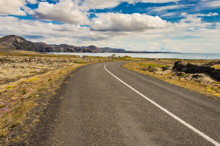 grindavik: Empty country narrow route to Grindavik - Iceland. Summer day. Stock Photo