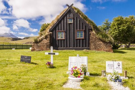 Old small graveyard in background wooden Vidimyri Church - Iceland  Stock Photo - 17169147