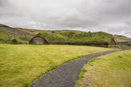 Viking house in Pjodveldisbaer, Iceland. Traditional mossy roofs. Stock Photo - 17881460