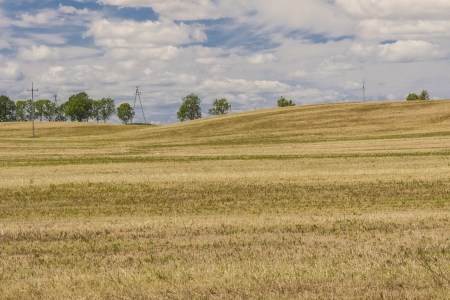 Harvest time - Polish rural view. White clouds and blue sky. Stock Photo - 17997858