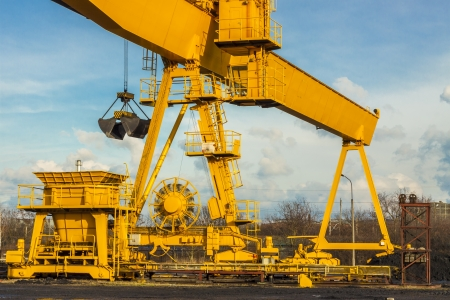 Yellow gantry crane on coal site in heating plant - Poland