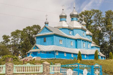 Blue old wooden Orthodox church near Ostroh town - Ukraine  photo