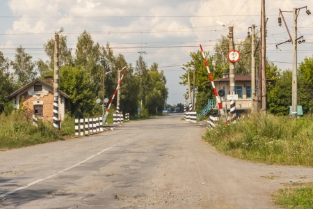 Empty rural route and open railway track barrier - Ukraine  photo