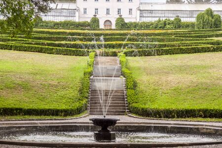 Small fountain in background hedgerow  Uman - Sofiyivsky park  Ukraine  photo