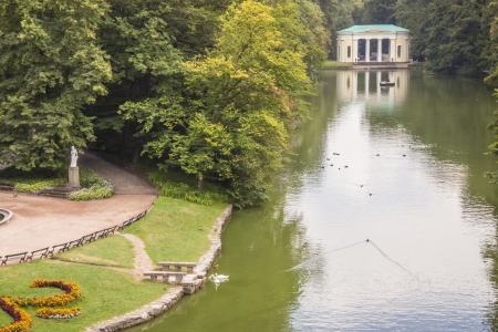 View on beauty lake in background main gate to Sofiyivsky park - Uman, Ukraine, Europe.