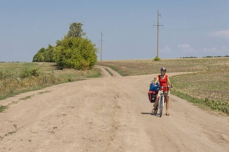 Women travel by bicycles - cross country on Ukraine  Summer sunny day  photo