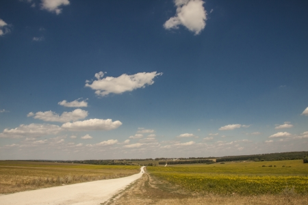 Rural gravel route and blue sky - sunny summer day  Ukraine, Europe  photo