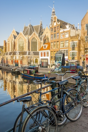 AMSTERDAM, NETHERLANDS - APRIL 22, 2013  Bicycles in Old town of Netherlands Capital in Amsterdam  Editorial