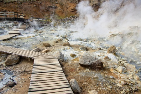 grindavik: Wooden path in geothermal area in Iceland. Summer day. Stock Photo