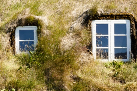 Iceland - typical mossy farme, two windows. Stock Photo - 19707480