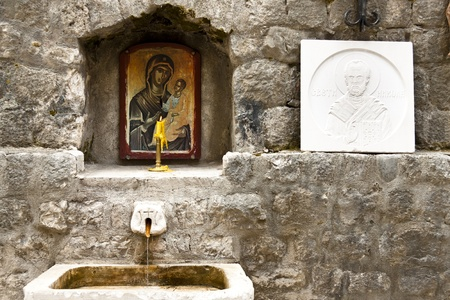 Old holy source in Kotor town. Montenegro. photo