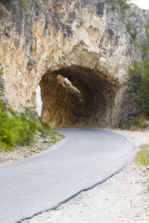 hairpin: Narrow mountains tunnel in Durmitor, Montenegro, Balkans.