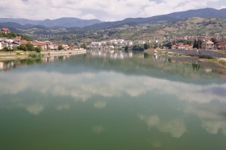 Drina diver and view on  Visegrad town from old Bridge. Bosnia and Herzegovina, Balkans. photo