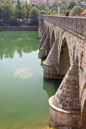 Old bridge in Visegrad town on Drina river - Bosnia and Herzegovina.