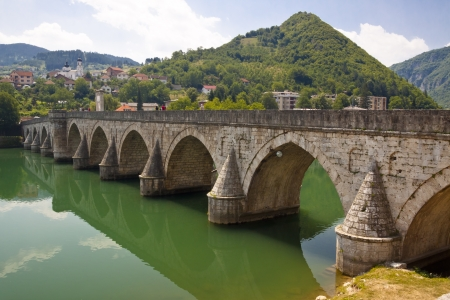 Old beauty bridge on Drina river in Visegrad town - Bosnia and Herzegovina. Stock Photo - 19708126