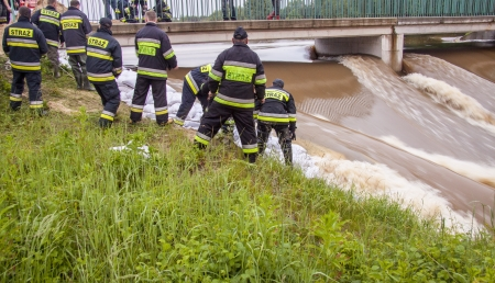ZIELONA, POLAND - JUNE 11 Man from fire brigade make sandbank from sand bags on june 11, 2013 in Kalety  High water level on Zielona lake and Mala Panew river