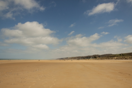 aiguille: Golden sandy Omaha beach in Normandy, France  Stock Photo