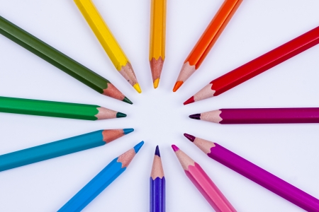 Pallet of colourful crayons on white background. photo