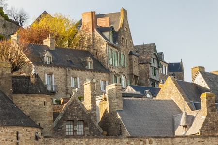 mount saint michael: Roofs and houses from the village under the monastry on the Mountain Saint Michel  Stock Photo