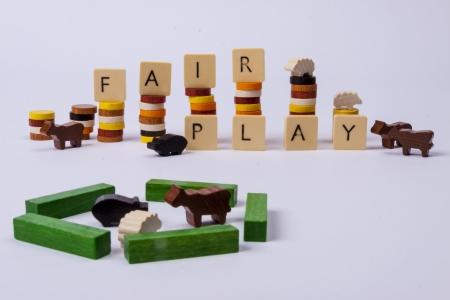 fair play: Fair play game - wooden column on white background