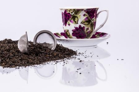 tea filter: Cup,  black tea on white background.
