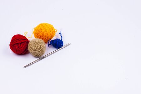 Crochet hook and wool on white background. photo