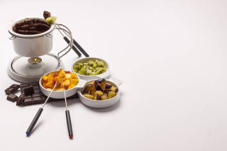 Chocolate fondue on white background - studio shot. photo