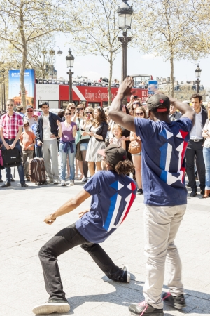 aerobica: PARIS, FRANCE -  APRIL 25 B-boy doing some breakdance moves in front a street crowd, at Arch of Triumph on april 25, 2013 in Paris  Its popular form of earnings in big cities