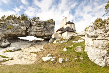 Big limestone rock in bacground view on old Bobolice castle - Poland, Silesia.