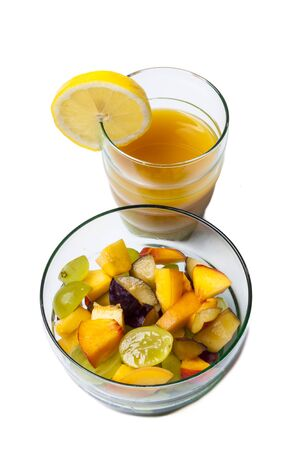 Fruit salad and orange juice isolated on white. photo