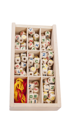 typesetter: Wooden letters in the box - creative game. Stock Photo
