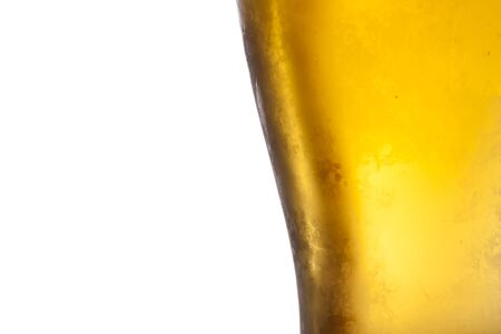 unbottled: Glass of light beer isolated on a white background.