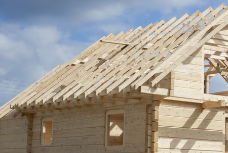 Unfinished roof in wooden home. Stock Photo