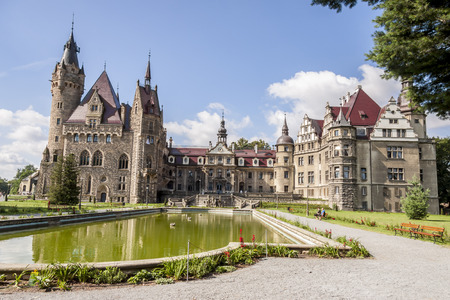 MOSZNA, POLAND - AUGUST 7: The Moszna Castle is a historic castle located in a small village on august 7, 2016 in Moszna. The castle is one of the best known monuments in Upper Silesia.