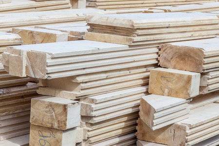 lumber mill: Wooden logs material for new house - construction site.