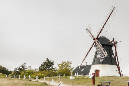 Windmill on the Mando island  in the Wadden Sea Park of Denmark, Europe.