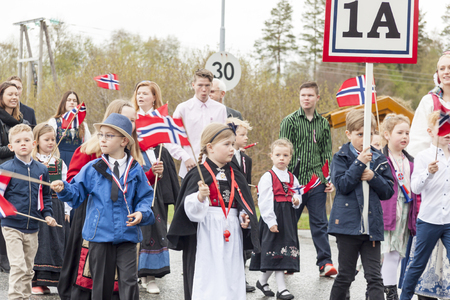 VERDAL, NORWAY - MAY 17, 2017: National day in Norway. Norwegians at traditional celebration and parade  on may 17, 2017 in Verdal. People on parde before school in Verdal. Constitution Day is the National Day of Norway. Editorial