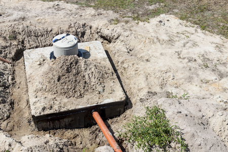 New concrete septic tank - construction site. Stock Photo