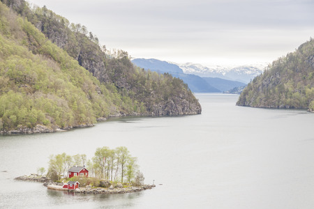 Red wooden cottage on island - Norway, Europe. Stok Fotoğraf