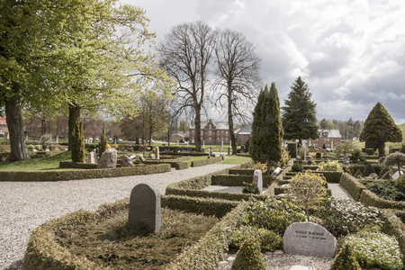 JELLING, DENMARK - MAY 9, 2017:  Graveyard  on the monument area which enjoys UNESCO World Heritage patronage on may 9, 2017 in Jelling, Denmark.