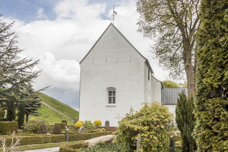 White church on the monument area   in Jelling, Denmark.