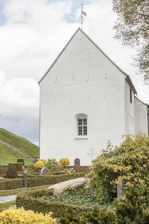 White church on the monument area  in Jelling, Denmark. Stock Photo