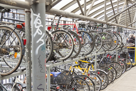 AARHUS, DENMARK - MAY 9, 2017: Bicycles parking in center of town  near train station on may 9, 2017 in Aarhus, Denmark. Editorial