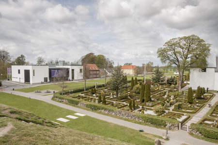 JELLING, DENMARK - MAY 9, 2017:  The modern Viking Museum sits on the monument area which enjoys UNESCO World Heritage patronage on may 9, 2017 in Jelling, Denmark.