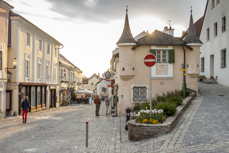MELK, AUSTRIA - APRIL 22, 2019:Tourist on main Street of Melk city on April 22,2019 in Melk in Austria. Melk is a city in the Lower Austria, next to the Wachau valley along the Danube river 報道画像